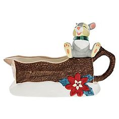 Thumper Happy Holidays Gravy Boat | Disney Store Thumper puts his feet up for the holiday as he relaxes on the log that forms this festive gravy boat. Bambi's woodland friend is all wrapped up with a warm winter scarf as he adds some Christmas flavoring to your dining table.
