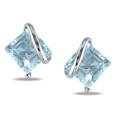 These enchaining earrings sparkle with blue topaz stones. This jewelry piece is made of sterling silver and features secure butterfly clasps.