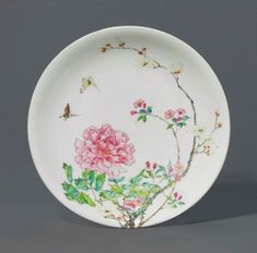 A RARE FAMILLE ROSE 'PEONY' DISH YONGZHENG SIX-CHARACTER MARK IN UNDERGLAZE BLUE WITHIN A DOUBLE CIRCLE AND OF THE PERIOD (1723-1735);  sold 200,000 GBP;  CHRISTIES 11/07/17.