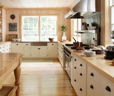 Farmhouse Kitchen: Love this wooden island/butcher table, windows!, bright cabinets, rustic hardware