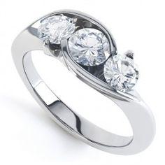 R3D009 - Cross-Over Three Stone Round Diamond Ring. One of our striking, original round brilliant cut 3 stone diamond rings.