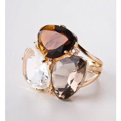 Anel com pedras e zircônias  COD. DO PRODUTO ANF0024    Anel semi jóia com cristal transparente, cristal fumê e zircônias.Banho de ouro 18K. Peso: 10 gramas. Peça única.