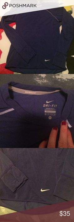 Nike Running Dry Fit Top Dark blue/purple Dry Fit running shirt. Longer hem in the back to cover while running. Thumb holes and reflective stitching. Nike Tops Tees - Long Sleeve