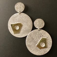 Only a slight change of shape gives an asymmetrical flair to these dangling post earrings. Textured gold bimetal fused onto sterling silver. Minimal Jewelry, Modern Jewelry, Statement Earrings, Drop Earrings, Gold Texture, Sterling Silver Earrings, Jewelry Design, Flourish, Wednesday