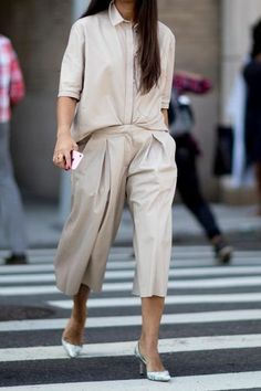 Loving this light tan button down blouse paired with paper bag trousers.. classic!