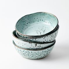 Rustic Speckled Bowl: This rustic speckled bowl is part of one of our popular collections of kitchen tableware here at Room356. The collection also includes a smaller nibble bowl and a mug. Each piece has a tactile, uneven glazed finish and unique speckled markings which adds to the collections character and charm. The rustic speckled bowl is ideal for small servings of salads and pastas or filled with nuts, dips, olives and tapenades.