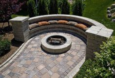 I love this fireplace with a stone bench concept for my backyard patio!