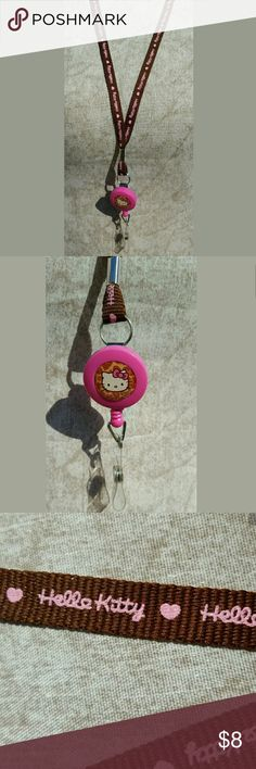 "Sanrio Hello Kitty Lanyard with Key Leash ID Badge Sanrio Hello Kitty Lanyard with Key Leash ID Badge Reel Key Chain : Camouflage  Adorable Hello Kitty lanyard in Kitty with Pink and Brown Camouflage Design.  Original Sanrio Hello Kitty Authentic Licensed Product.  - Reel ID Badge  Hello Kitty helps you keep your keys and I.D. handy with this smart key leash with name tag  - ID size : H 4"" x W 3""  - Approx Size : H 22""x W 3"" Hello Kitty Accessories Key & Card Holders"