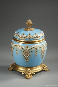 Antique vintage round casket/box in Bresse blue enamel and ormolu mounts resting on four feet richly decorated with foliage. The hinged lid is surmounted by a gilt bronze pine cone. The set in engraved with arabesques and floral motifs with threads in gold, heightened with white, red and green enamel. Enameled garlands imitating white pearls adorn the rim and the box.