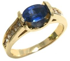 Sapphire and diamond ring with one 7x5 oval sapphire and 12 round diamonds 0.36tdw set in 14k yellow gold