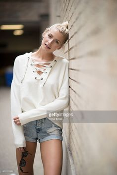 Lena Gercke is wearing a beige sweater and a waht pants is wearing a beige pulover that i salos confusing seen in the streets of Manhattan on September 9, 2016 in New York City.