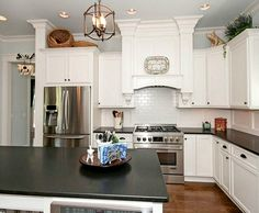 Love the stove area!  Modern White Farmhouse For Sale in North Carolina