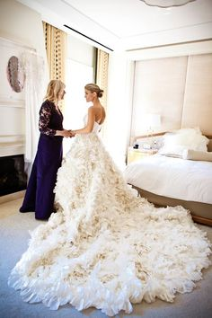 Stunning wedding dress with long feather train.