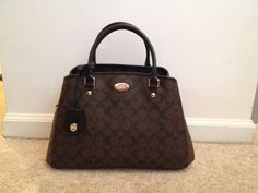 Check out Coach Signature Small Margot Carryall on Threadflip!