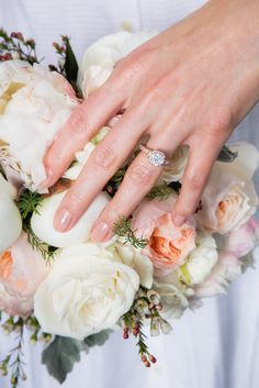 If you're all about the details, then your manicure will factor into that. You can't just wear any old pink or blush — it needs to perfectly complement your rings, skin tone, and, of course, the bouquet! Like this Not-Boring Nude color