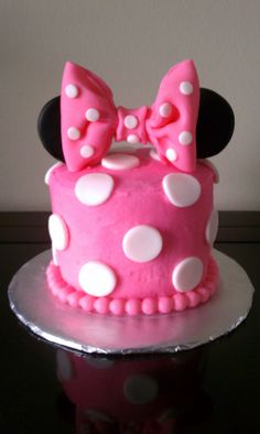 Minnie Mouse 1st Birthday Smash Cake - Buttercream (not very smooth) with fondant accents. Second bow ever! I was very proud of it.