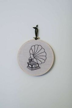 embroidery - blackstitch outlines of classic objects; gramaphone, telephone, trumpet, spinning wheel, etc