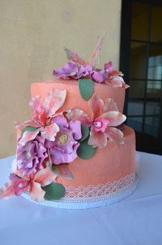 Coral bridal shower cake with gumpaste flowers and sugar butterflies