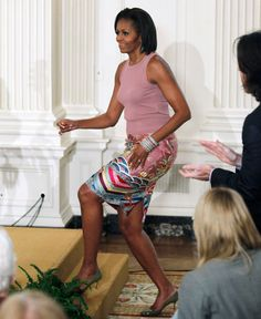 First Lady Michelle Obama, in a Naeem Khan skirt and tank, held a poetry workshop for students in Washington, DC.