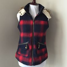 EUC plaid zip-up vest w removable fur lined hood Excellent used condition! Only worn twice. Super cute navy blue and red plaid. Has two front zipper pocket. Has a zipper closure in the front. Also the hood is removable with a zipper and the hood also has a two button closure. Inside of the hood is a super soft fleece and is also lined w faux fur. Mossimo Supply Co. Jackets & Coats Vests