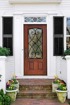 Jazz up a plain entry with decorative hinges, door handles, or nailhead trim. The wrought-iron grille design gives this door Garden District style. Front Door Entryway, Porch Entry, Wood Front Doors, Wooden Doors, Front Porch, Front Entry, Interior Barn Doors, Exterior Doors, Porches