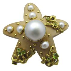Seaman Schepps Starfish Brooch With large center mobee pearl & 6 scattered smaller pearls.18k gold & green topaz.