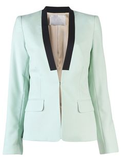 Zoe blazer in mint from A.L.C. This wool blend collarless blazer features a mock lapel with black panel, single hook and eye front closure, two front flap pockets, and slit at cuffs. Has single back vent and silk lining.