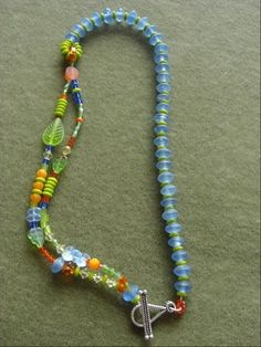 FB page: Annie Jacobi Jewelry...love the asymmetrical design...kind of tribal...kind of whimsical.