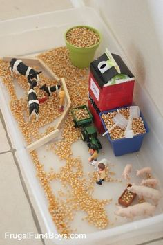 , Farm Sensory Play for Preschoolers - An orange juice container makes a simple grain silo that. , Farm Sensory Play for Preschoolers - An orange juice container makes a simple grain silo that really loads corn into a toy tractor! Farm Sensory Bin, Sensory Boxes, Sensory Table, Toddler Sensory Bins, Sensory Play For Toddlers, Toddler Fun, Farm Activities, Preschool Activities, 2 Year Old Activities