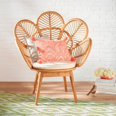 Our exclusive Daisie Rattan Chair is a playful yet sophisticated design that reminds you to bloom creatively wherever you