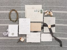 One of our favorite suites! All the charm from the South wrapped up into this suite. It includes handmade torn paper, handpainted artowrk with floral elements, custom monogram, vintage stamps, wax seal with silk ribbon from Tono & Co, and a little vow book. Love this natural color palette! | Photo by Alex Schon Photography ©Papertree Studio