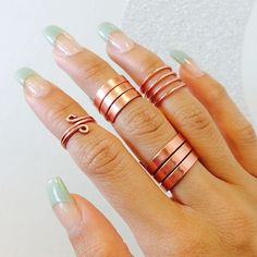 Yes, the nails are pretty, but I'm really in love with those copper rings and knuckle rings... deciding if I want to try and make those rings myself, not like they're that hard to make, especially with copper...