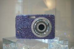"Swarovski Crystal encrusted camera.  Instead of ""cheese', say ""money"". ;-)"