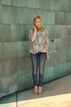 I love the floral bloussy top cinched with a colorful belt and paired with boyfriend jeans
