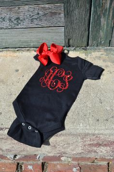 Hey, I found this really awesome Etsy listing at https://www.etsy.com/listing/206686335/glitter-monogrammed-onesie-with-bow-set