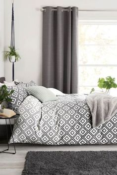 We'll never get bored of using grey in the home! It's the perfect shade to pair with white, creating a tranquil atmosphere in your bedroom. If this is a little too minimal though, opt for patterned bedding like our geo printed ombre bed set.