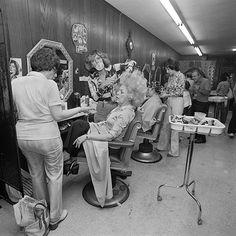 Getting her hair teased at Besame Beauty Salon, North Massapequa, NY, June 1979. © Meryl Meisler