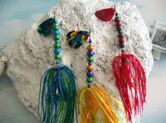 Homemade Fishing Lures- created with old guitar picks, glass beads and colorful silicone skirting