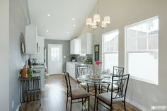 The Kraft #home dining room staging & remodel. Natural lighting, light wood floors, and recessed lighting on the vaulted ceilings give this house an ultra-beautiful brightness.  #veronohomes #realestate #houseflip #houseflipping #staging #home http://www.verono.com/kraft/