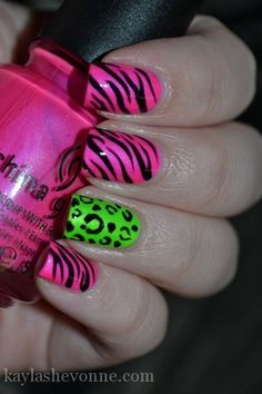 China Glaze Hang-ten Toes - a hot barbie pink with subtle shimmer. On my ring finger, I used I'm With The Lifeguard - a bright highlighter green shade with subtle shimmer. Freehanded the animal print designs using a black creme polish.