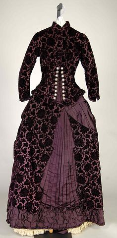 The asymmetry & play of textures & tones distinguish this grape & deep lavender silk wedding dress from 1881. French (?) @Metropolitan Museum of Art