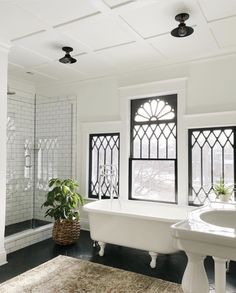 Wow! These windows are stunning! Actually the whole bathroom is perfect!