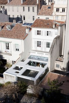 A geometric concrete structure has been added to a Marseille townhouse by French architecture studio Marion Bernard Agency