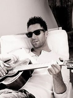 Adam Levine playing guitar