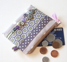 Handmade dotty coin purse embellished with buttons, spotty and striped ribbons and handcrafted fabric trim.