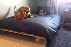 Futon Dreams' single futon base and mat used for a child's room.