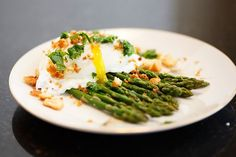 Poached Eggs over Roasted Asparagus #SundaySupper. Welcome to Springtime! ‪#SundaySupper is celebrating the occasion by featuring almost sixty Eggtastic recipes. I am honored to offer my Poached Eggs over Roasted Asparagus. Click her to see this recipe and links to all the wonderful recipes in this event: https://www.monicastable.com/poached-eggs-over-roasted-asparagus-sundaysupper