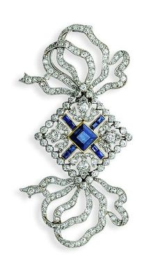 A BELLE EPOQUE SAPPHIRE AND DIAMOND BOW BROOCH, BY CARTIER The
