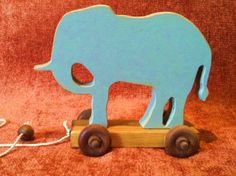 Victorianstyle Zoo Animal Pull Toys by WoodgrainShoppe on Etsy, $20.00    There's a rhino!