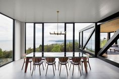 Contemporary dining room with amazing views of nature. Chalet Blanche by ACDF Architecture